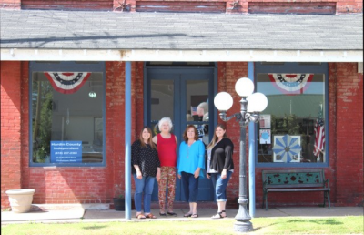 Pictured L to R outside the Hardin County Independent office in Elizabethtown, Illinois: Jennifer Rash Lane, owner, editor, publisher; Susie Hurford Williams, volunteer; Julie Hurford Farley, retired owner, editor and publisher; Heather Rash, ad designer/reporter.  (Hardin County Independent)