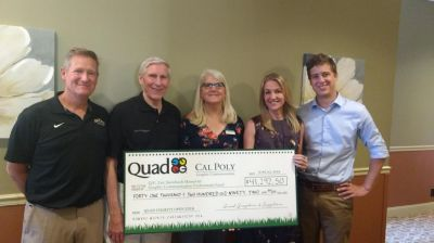 From left to right: David Cohune, assistant dean for advancement for Cal Poly's College of Liberal Arts; Raymond Harman, Cal Poly Graphic Communication Advisory Board member; graphic communication Associate Professor Colleen Twomey; Jeana Steinbach, Eric Steinbach's wife; and Nic Steinbach, Eric Steinbach's son, accept the donation to the Graphic Communication Department.