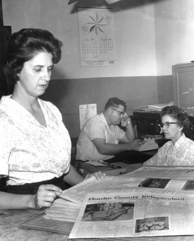 "The late Betty, pictured left, and Noel Hurford, pictured center (former owner and editor respectively), work at the Hardin County Independent in Elizabethtown with office clerk, Gladys McDowell  — year 1966. Retired owner, editor and publisher Julie Hurford Farley was 12 then. Julie and her sister, Heather, grew up in the newspaper business; to this day, they can smell the ink from the old press on paper day and can see the line of people out on the sidewalk waiting for their copy ""hot off the press."" Times sure have changed with the invention of computers. Ten years after this picture was taken, Julie began working for her dad at the Independent. She retired last year, with daughter Jennifer Rash Lane now at the helm."